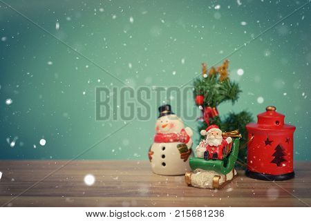Christmas holiday background with Santa and decorations. Christmas landscape with gifts and snow. Merry christmas and happy new year greeting card with copy space. Christmas celebration holiday background.