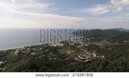 Ascending aerial drone shot over Phuket Hills and beaches, Thailand