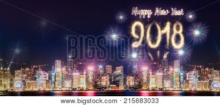 Happy new year 2018 firework over cityscape building near sea at night time celebrationmock up Banner for advertise on social media.