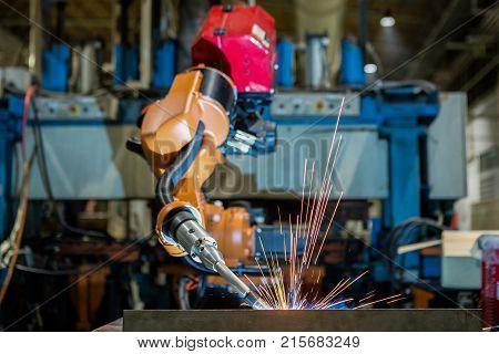 Robot is test run welding program .