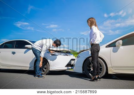 Two Drivers arguing after a car accident on the road
