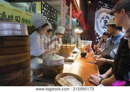 Shanghai, China - Nov 6, 2017: People buying Shanghai dumpling, also called xiaolongbao at a food stall. It is a type of popular traditional food in China.