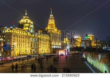 Shanghai, China - Nov 3, 2017: View of The Bund, also called Waitan, in Shanghai. It is a waterfront area in central Shanghai with many historical buildings built by former foriegn settlements.