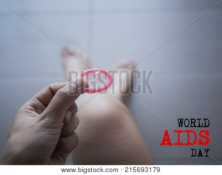 Woman holding condom for remember about protection Safe sex concept.