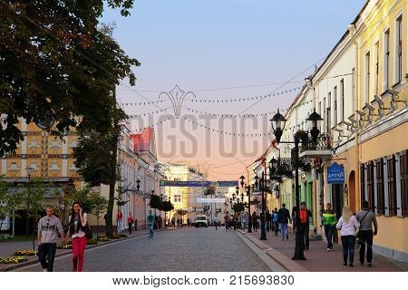 Grodno Belarus - September 02 2012: Pedestrianised street with a lot of tourists walking in Grodno city center Belarus
