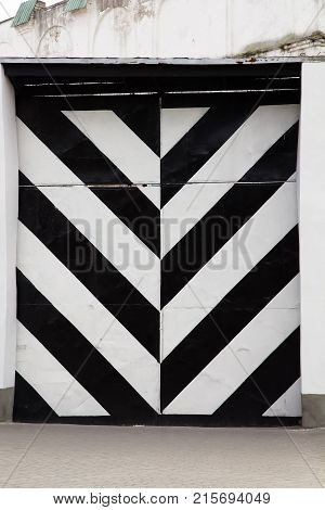 old door with black and white stripes closeup