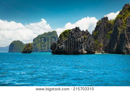Scenic landscape with mountain islands and blue lagoon El Nido Palawan Philippines Southeast Asia. Exotic scenery. Popular landmark famous destination of Philippines