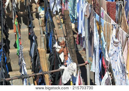 Mumbai India - October 12, 2017: Unidentified Man Hangs Laundry In Dhobi Ghat Laundromat Mumbai.