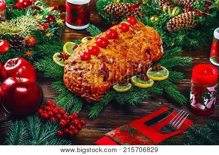 Christmas Table Dinner Time With Roasted Meats, Candles And New Year Décor. Background Thanksgiving