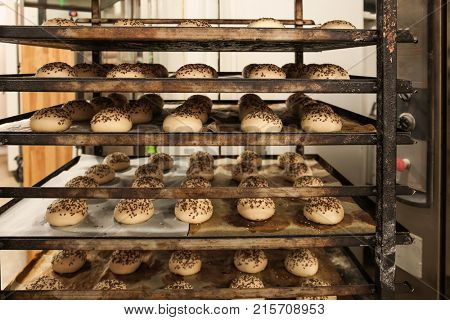 Buns on shelving in bakery