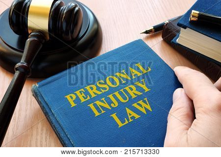 Personal injury law and gavel on a desk.