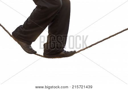 Tight rope walker's legs isolated. Feet of balancing on rope against white background