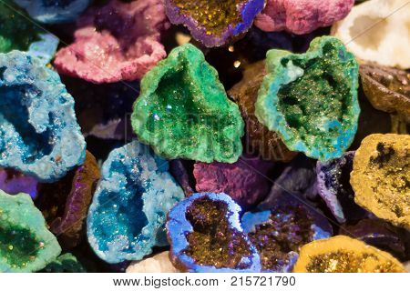 Colourful geodes cut open. Vibrant geological structures showing crystalline minerals within