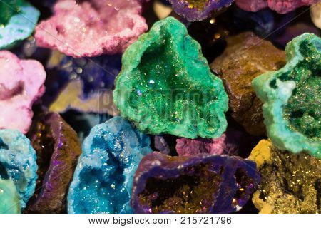 Differently coloured geodes cut open. Vibrant geological structures showing crystalline minerals within