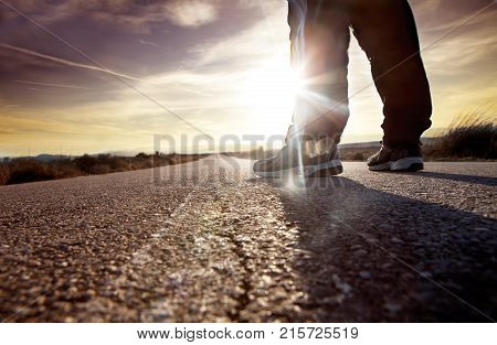 anonymous man on the road and sunset landscape.travel concept