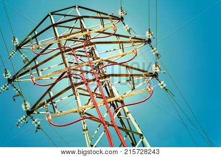 Electricity concept. Electric pylon detail over blue sky