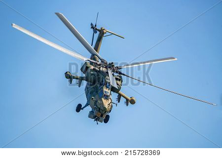 ROSTOV-ON-DON, RUSSIA - CIRCA AUGUST, 2017: Russian Air Force Mil Mi-28 Havoc military attack combat helicopter in gray camouflage flying detail exterior front close up aerial view