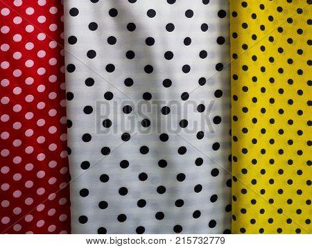 Various color dot polka textile fabric. Coloured cloth.