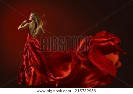 Fashion Model Dance in Red Dress Dancing Beautiful Woman Flying Fluttering Fabric Happy Girl Rear Back View