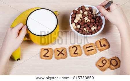 Healthy Food For A School Children. Milk, Banana And Funny Cookies With Numbers. Child Has Breakfast