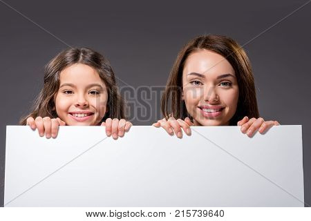 Mother And Daughter Holding White Board