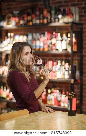 Attractive Woman Taste Red Wine In The Restaurant