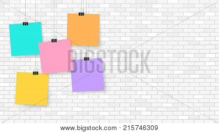 Posters on binder clips. Paper templates on brick wall. Realistic mock up. Empty notepad sheet for your business design. Brick wall. Vector templates for lettering quote images or logos.