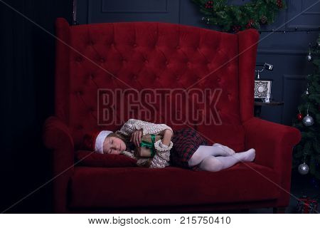 Happy Girl Is Sleeping Sweetly Near A Christmas Tree
