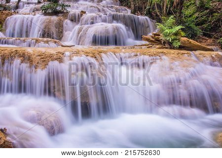 Mae Kae waterfall the Most Famous in Lampang Thailand. Beautiful silky waterfall flow through stones. Mountain stream running over rocks.