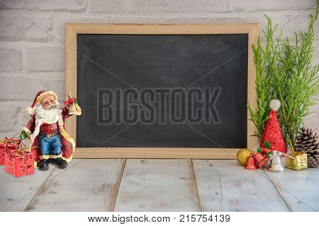 Christmas decoration on wooden background and blackboard with copy space.