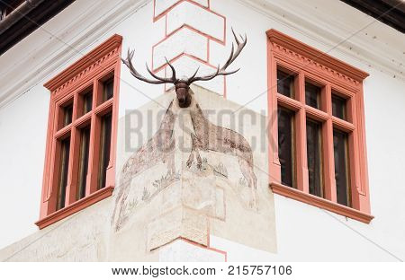 Sighisoara Romania October 08 2017 : The corner of the house decorated with a decorative chandelier in the castle of old city. Sighisoara city in Romania