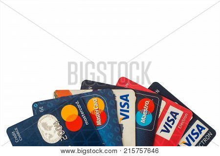 Sarajevo Bosnia and Herzegovina - Jun 25 2017: closeup pile of credit cards Visa and MasterCard credit debit and electronic. Isolated on white background with clipping path. Design element.