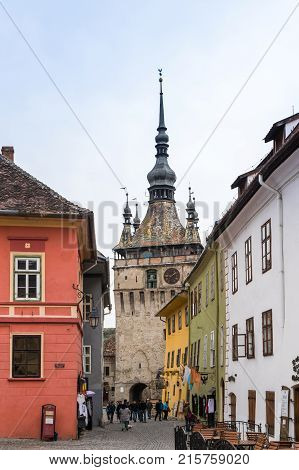 Sighisoara Romania October 08 2017 : Tourists walk on the Fortress Square in the castle of old city. Sighisoara city in Romania