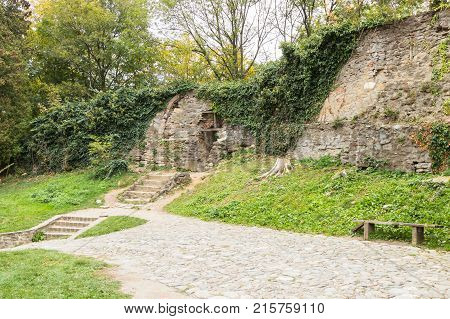 Steps leading to the passage in the fortress wall near to the Church of the Deal (St. Nicholas) in the castle in Old City. Sighisoara city in Romania