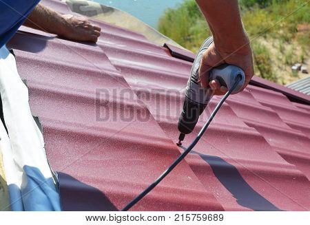 Roofing contractor Roof Repair. Roofer install metal roof tile. House roofing construction.