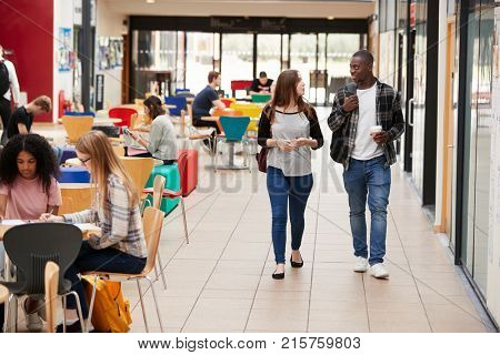 Communal Area Of Busy College Campus With Students