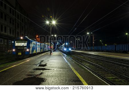 KOLOBRZEG, WEST POMERANIAN / POLAND - 2017: Express train and local train waiting for passengers at the platform at the train station