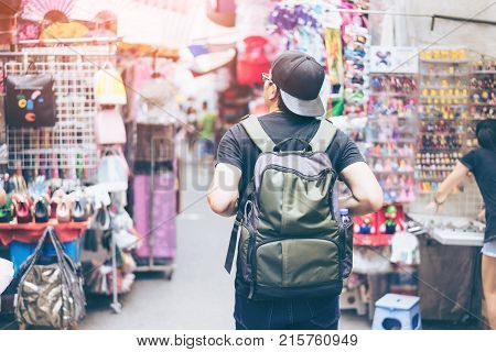 Young man traveler is visiting at Mongkok in Hong Kong.