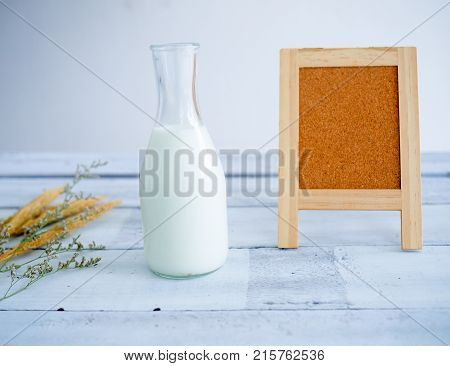 milk on table. , Milk with Board Bagasse on table.