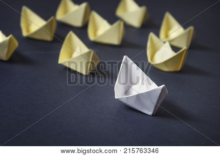 Leadership concept - white paper ship leader leading group