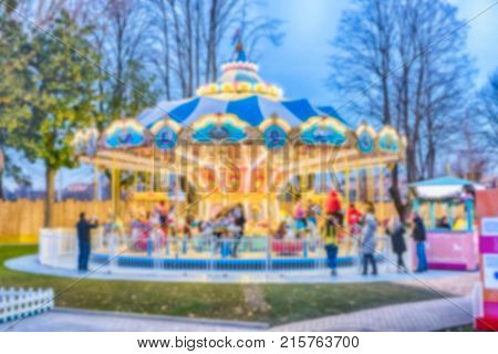Defocused Background Of An Old Fashioned Carousel At Dusk