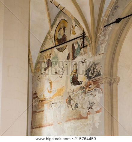 Sighisoara Romania October 08 2017 : Painting with the text on the wall of Church of the Deal (St. Nicholas) in the castle in Old City. Sighisoara city in Romania