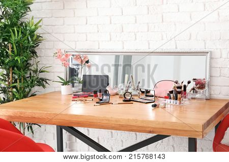 Set of decorative cosmetics and beauty accessories on dressing table indoors