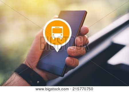 Man using smartphone app to purchase bus electronic ticket for public transportation close up of male hands with mobile phone selective focus