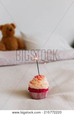 Horizontal Smartphone Appropriate Screen Photo Of Happy Birthday Surprise Cupcake With Sparkler Candle Burning Stands On
