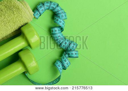 Tape Measure In Cyan Color Near Lightweight Barbells, Copy Space