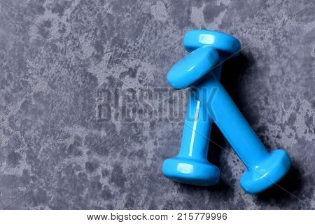Barbells Placed Crosswise, Top View. Dumbbells Made Of Cyan Plastic