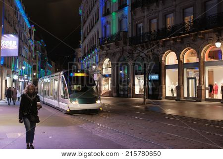 STRASBOURG FRANCE - NOVEMBER 27 2017: French tramway going to Central Train station with the Traditional Christmas market in the historic Strasbourg Alsace France
