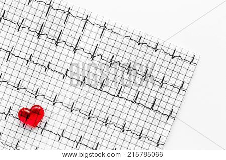 Examine the heart to prevent heart disease. Heart sign and cardiogram on white background top view.