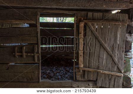 Barn stall in a vintage rough hewn log barn horizontal aspect